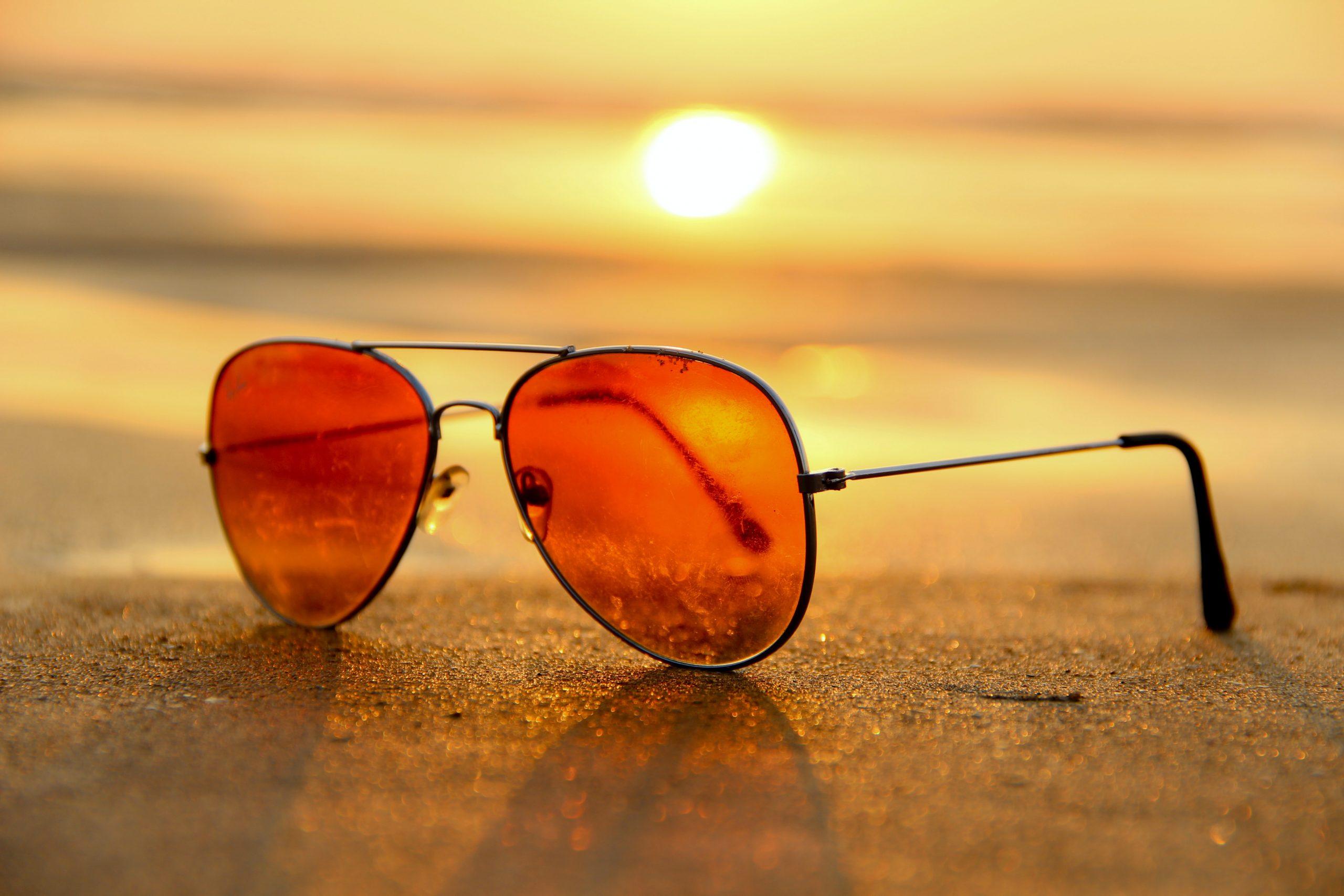 social media stats during Coronavirus graph on a laptop sunglasses-sunset-summer-sand